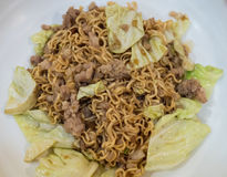 Stir fried instant noodle with pork and cabbage Royalty Free Stock Photography