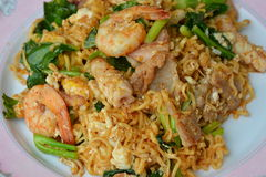 Stir fried instant noodle with seafood and Chinese kale Royalty Free Stock Photo