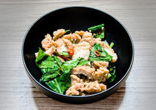 Stir fried kale with crispy chicken Stock Images