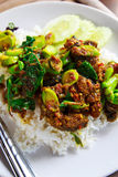Stir-fried kale with crispy fish Stock Image