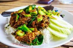 Stir-fried kale with crispy fish. Stir-fried kale green with crispy fish stock image