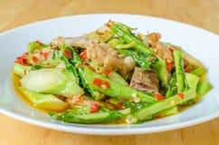 Stir fried kale with crispy pork Royalty Free Stock Images