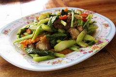 Stir Fried Kale with crispy pork Royalty Free Stock Image