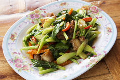 Stir Fried Kale with crispy pork Stock Image