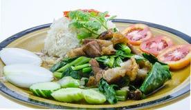 Stir-fried kale with crispy pork and rice Stock Photo