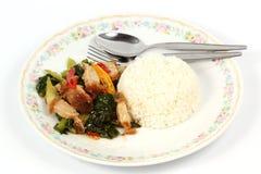 Stir fried kale Crispy pork with steamed rice Stock Photos