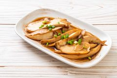 Stir-fried king oyster mushroom in oyster sauce. Healthy, vegan or vegetarian food style stock images