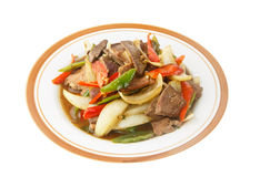 Stir fried meat with chilli pepper isolated on white Stock Photography