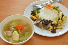 Stir fried mixed vegetable with pork liver and egg tofu soup. Cup stock image