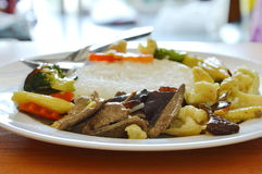 Stir fried mixed vegetable with pork liver on rice. Stir fried mixed vegetable with pork liver on plain rice royalty free stock images