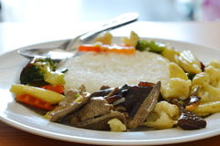 Stir fried mixed vegetable with pork liver on rice Royalty Free Stock Images