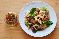 Stir fried mixed vegetable with seafood and chili fish sauce Royalty Free Stock Photos