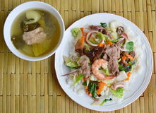 Stir fried mixed vegetable with seafood on rice and pickled Chinese cabbage soup Stock Photography