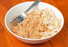 Stir fried mung bean noodle in bowl on the wooden table Royalty Free Stock Photo