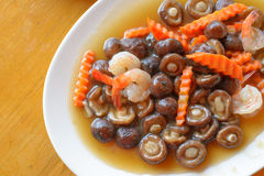 Stir fried mushroom, carrot and shrimp in oyster sauce Stock Images