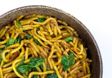Stir-fried noodle with bacon and spinach Royalty Free Stock Images