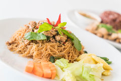 Stir-fried noodle, pork and basil Stock Photography
