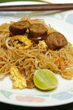 Stir fried noodle Thai style with Thai sausages Royalty Free Stock Photos