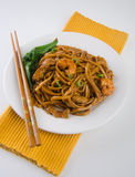 Stir-fried noodles with chicken and seafood Stock Images
