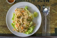 Stir Fried Noodles with Chicken with vegetable and fish sauce on the wooden Table. Thai food royalty free stock image