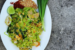 Stir-fried noodles, green lines put the squid and pork. Royalty Free Stock Image