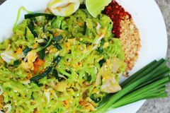 Stir-fried noodles, green lines put the squid and pork. Royalty Free Stock Photography
