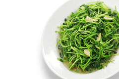 Stir fried pea shoots with garlic Stock Photos