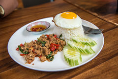 Stir Fried Pork with Basil and Eggs with Fish Sauce and chilli stock image
