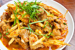 Stir Fried Pork Belly and Red Curry Paste with Bamboo Shoot Royalty Free Stock Images