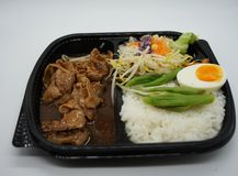 Stir fried pork with boil egg in the box set. On white backgroung stock photo