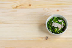 Stir Fried Pork with Chinese Chives Flower and Garlic on wooden Stock Image