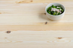 Stir Fried Pork with Chinese Chives Flower and Garlic on wooden Royalty Free Stock Photography