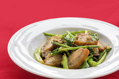 Stir fried pork and crispy Kale. Kale stir fried with crispy pork Royalty Free Stock Photo