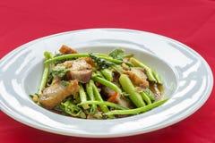 Stir fried pork and crispy Kale. Kale stir fry with crispy pork Royalty Free Stock Photo