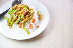 Stir fried pork and curry paste Stock Photos