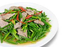 Stir-fried pork and garlic chive on white background,cl. Ipping path stock photos