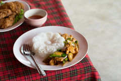 Stir fried pork with green chili(Moo Pad Prik). Serve on table with other food background Royalty Free Stock Images