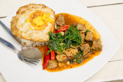 Stir Fried Pork with Holy Basil and Fried egg Stock Photo