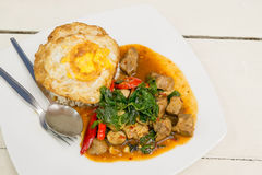 Stir Fried Pork with Holy Basil and Fried egg Stock Image
