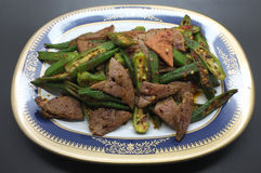 Stir fried pork liver with okra, lady's finger Royalty Free Stock Photos