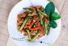 Stir fried pork and red curry paste with string bean Stock Photos