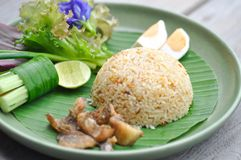 Stir-fried rice with fried fish and egg. Thai food stock photography