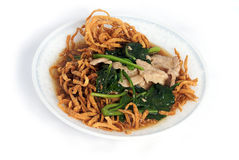 Stir-fried rice noodle with gravy on dish royalty free stock photography