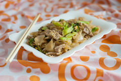 Stir fried rice noodle with pork Stock Images