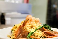 Stir fried rice noodles Hong Kong. With squid shrimp Stock Photo