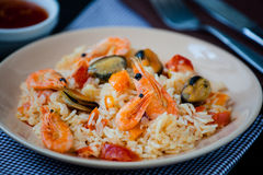 Stir fried rice noodles with prawns and mussels Stock Photo