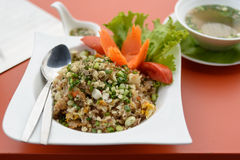 Stir fried rice with pork. Serve on colourful table Royalty Free Stock Photos