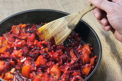 Stir-fried root vegetables in a frying pan Stock Images