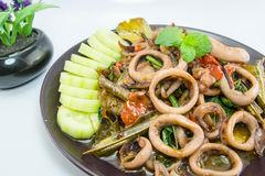Stir-fried salted egg with squid on dish, traditional Thai food Stock Photos