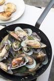Stir-fried sea mussels in pan Stock Photo